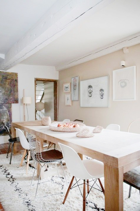 Blush dining room with mismatched chairs