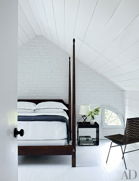 Bright white bedroom with vaulted ceilings