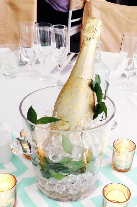 Gold champagne bottle centrepiece