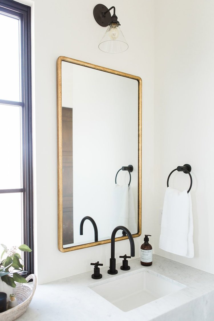 25Guest+bathroom+with+double+vanity,+gold+mirrors,+and+patterned+tile