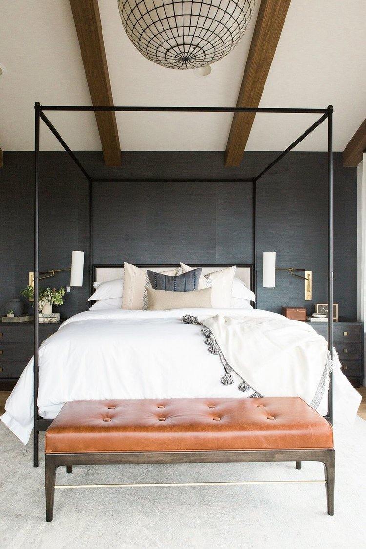 28Master+bedroom+in+blue+grasscloth+wallpaper,+statement+chandelier,+and+leather+bench